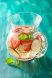 Refreshing summer drink with strawberry cucumber lime in jar Stock Photos