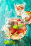 Refreshing summer drink with strawberry cucumber lime in jar and Stock Photo