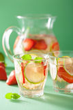 Refreshing summer drink with strawberry cucumber lime in jar and Royalty Free Stock Images
