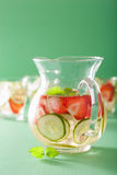 Refreshing summer drink with strawberry cucumber lime in jar and Stock Photos