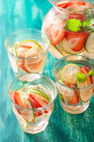 Refreshing summer drink with strawberry cucumber lime in jar and Royalty Free Stock Photos