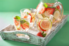 Refreshing summer drink with strawberry cucumber lime in jar and Stock Photography