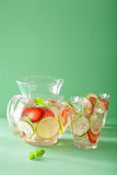 Refreshing summer drink with strawberry cucumber lime in jar and Royalty Free Stock Photography