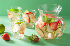 Refreshing summer drink with strawberry cucumber lime in jar and Royalty Free Stock Image