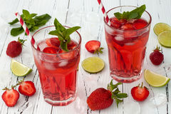 Refreshing summer drink with strawberry, lime and mint. Stock Photo