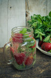 Refreshing summer drink with strawberry Stock Photos