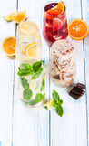 Refreshing summer drinks. Delicious refreshing summer drinks . Sangria , lemonade, iced chocolate drink , a mojito on a white background . Ice cubes around stock photos