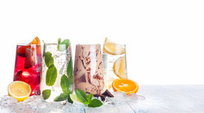 Refreshing summer drinks. Delicious refreshing summer drinks . Sangria , lemonade, iced chocolate drink , a mojito on a white background . Ice cubes around royalty free stock photo