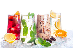 Refreshing summer drinks. Delicious refreshing summer drinks . Sangria , lemonade, iced chocolate drink , a mojito on a white background . Ice cubes around royalty free stock photos