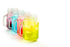 Refreshing summer drinks in jar. With ice and mint on a white background Stock Photos