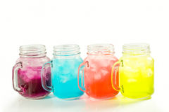 Refreshing summer drinks in jar. With ice and mint on a white background Royalty Free Stock Photos