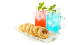 Refreshing summer drinks in jar. With ice and mint on a white background Royalty Free Stock Image