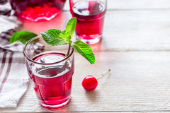Refreshing summer homemade cocktail with cherry and mint. Royalty Free Stock Photography