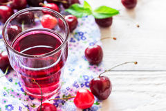 Refreshing summer homemade cocktail with cherry and mint. Royalty Free Stock Image