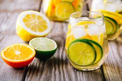 A refreshing summer ice-cold drink. White wine sangria in glass with lime, lemon and orange stock image