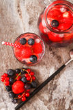 Refreshing summer ice tea or lemonade with fresh homemade fruits Stock Photos