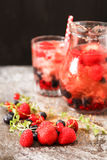 Refreshing summer ice tea or lemonade with fresh homemade fruits Royalty Free Stock Images