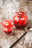 Refreshing summer ice tea or lemonade with fresh homemade fruits Stock Photography