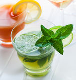 Refreshing summer mint cocktail. Cocktails and longdrinks garnished with fruits for summer royalty free stock photo
