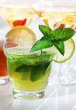 Refreshing summer mint cocktail. Cocktails and longdrinks garnished with fruits for summer royalty free stock photography