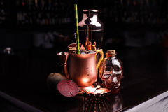 Refreshing summer punch and copper bar tools on dark background stock photos