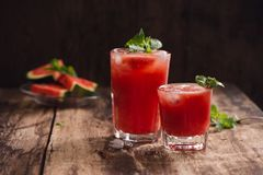 Refreshing summer watermelon juice in glasses with slices of wat. Ermelon Royalty Free Stock Photos