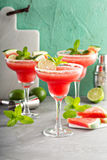 Refreshing summer watermelon margaritas with lime Royalty Free Stock Images