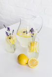 Refreshing summertime lemonade with lavender flowers in glasses and jar Royalty Free Stock Photography
