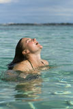 Refreshing swim in the tropics Stock Photography