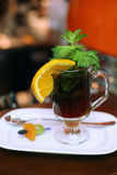 Refreshing tea with mint and sliced orange in a gl Stock Image