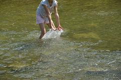 Refreshing walk in river in hot sommer. With dog Royalty Free Stock Image