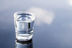 Refreshing Water In Transparent Glass With Reflection Against Bl Royalty Free Stock Image
