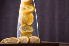 Refreshing water with orange . Homemade lemonade  on wooden back Stock Images