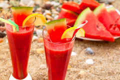 Refreshing watermelon on the beach Stock Photos