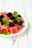 Refreshing watermelon salad with blackberries and mint. Fresh star shaped watermelon. Refreshing watermelon salad with blackberries and mint. Fresh star shaped Stock Photo