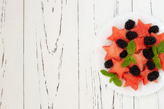 Refreshing watermelon salad with blackberries and mint. Fresh star shaped watermelon. Royalty Free Stock Image