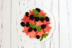 Refreshing watermelon salad with blackberries and mint. Fresh star shaped watermelon. Stock Photography