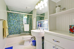 Refreshing white bathroom with aqua tile wall trim Royalty Free Stock Photography