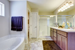 Refreshing white bathroom with glass door and bath tub Stock Photos