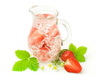 Refreshment beverage with strawberries and ice cubies Stock Images