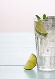 Refreshment cocktail with lime, mint and ice cubes. Close up Stock Photos