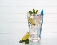 Refreshment cocktail with lime, mint and ice cubes Stock Images