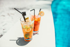 Refreshment drinks at pool bar served ice cold on a sunny day Royalty Free Stock Images
