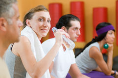 Refreshment during fitness exercises Stock Photos