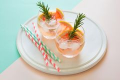 Refreshment grapefruit cocktail with rosemary on white wooden board Royalty Free Stock Image