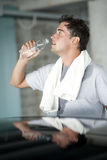 Refreshment after sport training. A man refreshing himself after sport training Royalty Free Stock Image