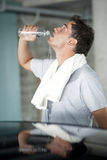Refreshment after sport training. A man  refreshing himself after sport training Royalty Free Stock Photos