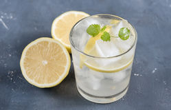 Refreshment Summer drink. Traditional lemonade with lemon mint and ice. On white Stock Photography