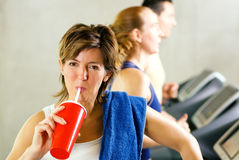 Refreshment after the treadmill Royalty Free Stock Photography