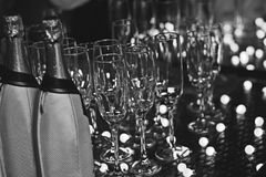 Refreshments bar at Silver Wedding Party B&W. Silver Wedding Anniversary Party. Refreshments including champagne. Here is the illuminated surface with the stock image